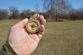 foto of compasses  - Compass in the hand on a walk - JPG