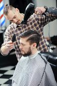 stock photo of barbershop  - Making a hairdo - JPG