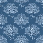 picture of indian blue  - Indian traditional paisley flourish seamless pattern of flowers with white outline petals ornately on pale blue background for textile or wallpaper design - JPG