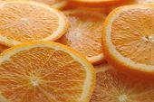 pic of valencia-orange  - background made of few sliced juicy oranges - JPG