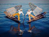 image of fishermen  - Myanmar Traditional Burmese fishermen balancing with fishing nets at Inle lake - JPG