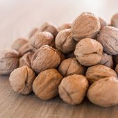 stock photo of dry fruit  - A pile of walnuts the best of the dried fruit - JPG