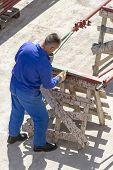 image of air paint gun  - Photo of the Paint worker painting metal designs - JPG