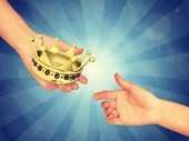 image of pinky  - Hand passing gold crown - JPG