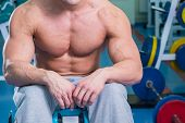 stock photo of abdominal muscle man  - A man pumping abdominal muscles. Man in the gym. 