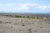 picture of breaker  - old wave breakers at the mouth of the cashen on ballybunion beach on the wild atlantic way - JPG