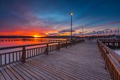 stock photo of pier a lake  - Beautiful lake landscape with vibrant sunset and pier - JPG