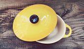 stock photo of pot roast  - A little yellow cooking pot for julienne  - JPG