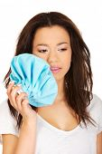 stock photo of toothache  - African teen with toothache and ice bag - JPG