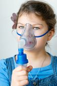 foto of asthma  - Girl with asthma inhaler - JPG