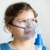 pic of inhalant  - Girl with asthma inhaler - JPG