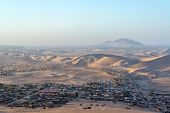 stock photo of ica  - Slums from the city of Ica Peru spilling out into the desert