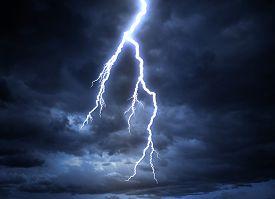 stock photo of shock awe  - A lightning strike on the cloudy sky - JPG
