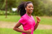 African American Woman Runner Jogging Outdoors - Fitness, People And Healthy Lifestyle poster