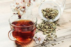 picture of black tea  - Black tea in a cup on a wooden table - JPG