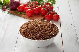 stock photo of buckwheat  - Buckwheat tomatoes onion parsley - JPG