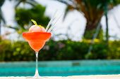 Frozen Strawberry Margarita Cocktail At The Edge Of A Resort Pool.  Concept Of Luxury Vacation poster