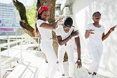 Three Stylish African American Friends, Wear On White Clothes. Street Fashion Of Young Black People. poster
