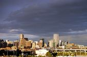 DENVER, COLORADO - AUG 24: Stormy Denver skyline, shot from Invesco Field at Mile High stadium, at t