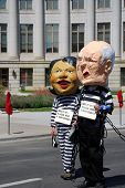 DENVER â?? AUGUST 26: Demonstrators posing as Secretary of State Condoleezza Rice and Vice President Dick Cheney walk along a street during the Democratic National Convention August 26, 2008 in Denver.