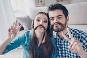 Go Crazy! Have Fun Together At Home. Playful Funny Couple Of Teens Is Making A Mustache Of Girl`s Ha poster