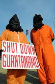 WASHINGTON - JAN 20: Hooded demonstrators demand the closing of Guantanamo during the inauguration o
