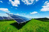 Solar power station against the blue sky. Alternative energy concept poster