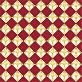 A seamless pattern of Fleur de Lys tiles on red background. EPS10 vector format.
