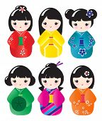 Kokeshi dolls in various designs isolated on white. Also available in vector format.