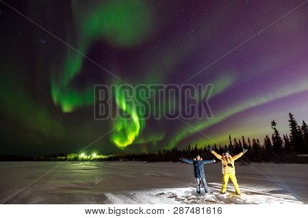 poster of Multicolored Green Violet Vibrant Aurora Borealis Polaris, Northern Lights In Night Sky Over Winter