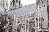 Catholic Church. Baroque And Gothic Architecture. Vaulted Window With Stained Glass On Facade Of The poster
