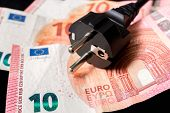 Electric Power Plug And European Money On Background - Expensive Electricity Consumption Concept poster
