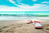 Pink And White Sandals On Sand Beach. Casual Style Flipflop Were Removed At Seaside. Summer Vacation poster