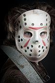 foto of machete  - maniac in mask and machete in his hand posing over dark background - JPG