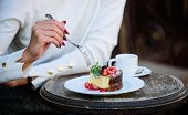 Appetite Concept. Dessert Cake Cup Of Coffee And Female Hand With Fork Close Up. Piece Of Cake With  poster