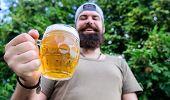 Hipster Brutal Bearded Man Hold Mug Cold Fresh Beer. Man Relaxing Enjoying Beer In Summer. Alcohol D poster