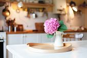 Pink Hydrangea Flower On Wooden Serving Tray. Morning Kitchen Scene. Cozy Home Atmosphere Hygge. Spr poster