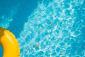 Floating Ring On Blue Water Swimpool With Waves Reflecting In The Summer Sun. Lazy River.water Pool  poster
