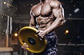 Brutal Strong Bodybuilder Athletic Man Pumping Up Muscles Workout Bodybuilding Concept Background -  poster