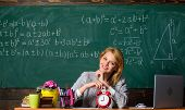 Take Your Time. Teacher With Alarm Clock At Blackboard. Time. Study And Education. Modern School. Kn poster