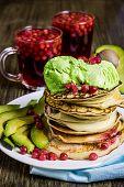 Homemade Pancakes With Avocado Ice Cream And Avocado Slices On A White Plate. Blue Napkin. Homemade  poster