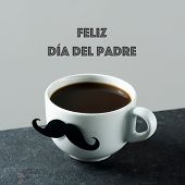 the text feliz dia del padre, happy fathers day in spanish, and a white ceramic cup with coffee, wit poster