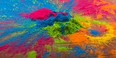 Abstract colorful Happy Holi background. Color vibrant powder on wood. Dust colored splash texture.  poster