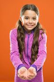 Look Here. Kid Happy Smiling Face Show Something In Both Hands Copy Space. Girl Demonstrate Product. poster