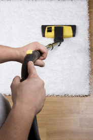 pic of house cleaning  - Tube cleaner on the carpet and cleaning - JPG