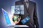 Business man with laptop,mobile phone,touch screen device  (Elements of this image furnished by NASA