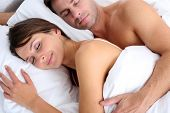 Closeup of couple sleeping in bed