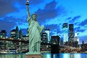stock photo of statue liberty  - Brooklyn Bridge and The Statue of Liberty at Night - JPG