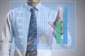 Businessman with show a graph