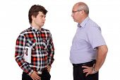 Strict father talking with his young son, isolated on white background